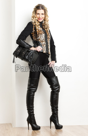 standing woman wearing fashionable clothes and