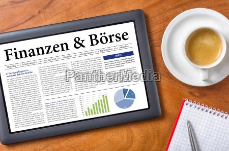 tablet on desk finance and