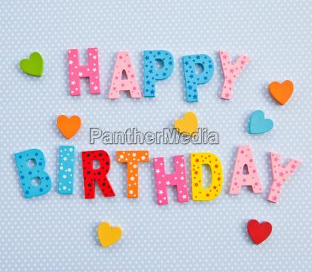 happy birthday auf blauem hintergrund