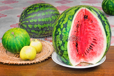 ripe sliced watermelon and apples