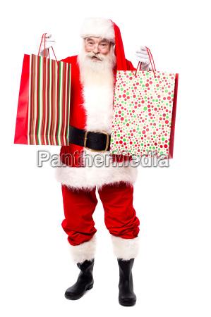hier sind ihre geschenktaschen frohe weihnachten