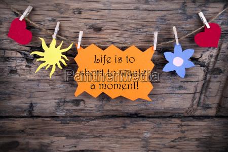 orange label with life quote life