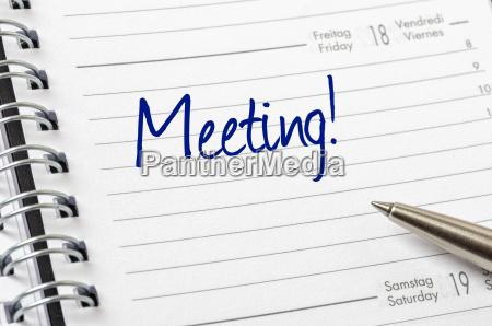 terminkalender mit dem eintrag meeting