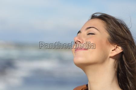 closeup of a woman breathing fresh