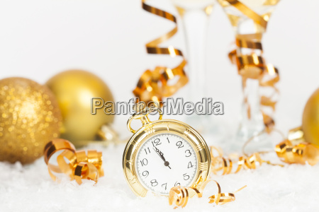 old golden clock close to midnight