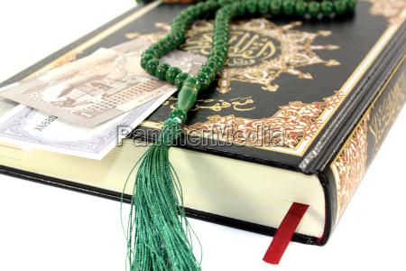 slammed koran with pakistani rupee