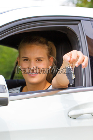 young driver with key in hand