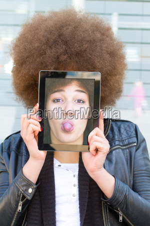 young woman with tablet with funny