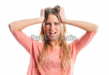 woman tearing her hair