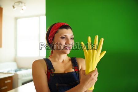 young hispanic woman with yellow latex