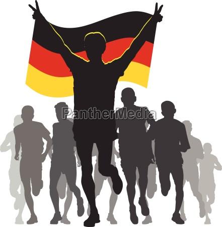 athlet mit deutschland fahne am ziel