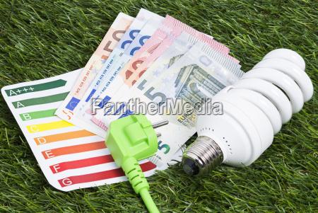 energy saving lamp and money on