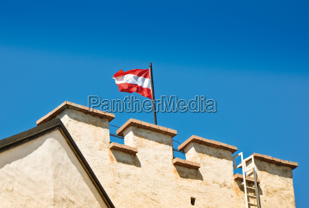 austria flag on salzburg castle
