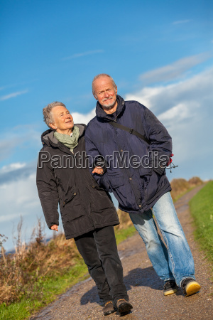 senior happy couple making a walk