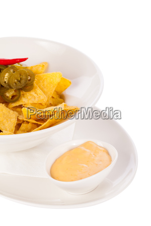 bowl with nachos tortillas with pepperoni