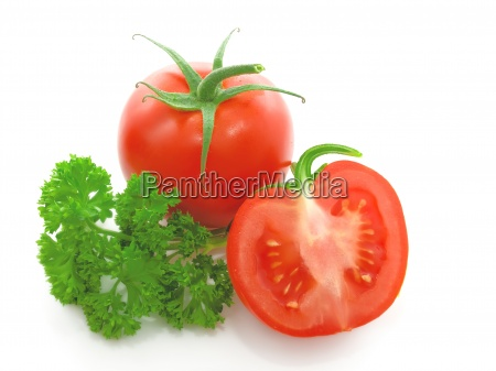 red tomato with parsley isolated on