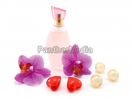 bottle of perfume and orchid isolated