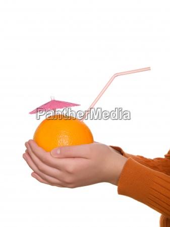 fresh orange juice in hand on