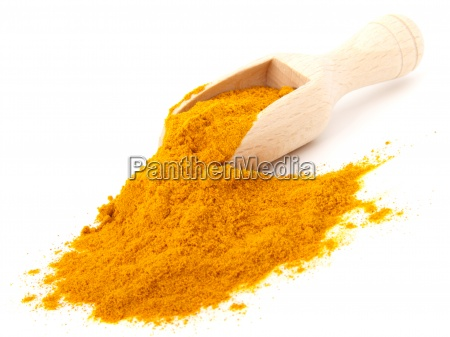 turmeric over the spoon isolated