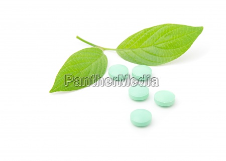 pills with green leaf isolated on