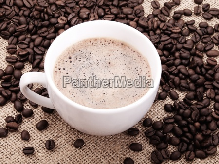 coffee beans with cup on canvas