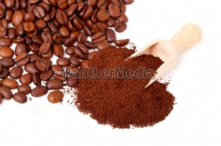 fresh ground coffee with wooden spoon