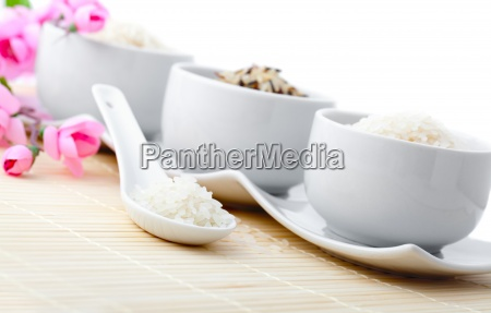 porcelain bowls of uncooked rice