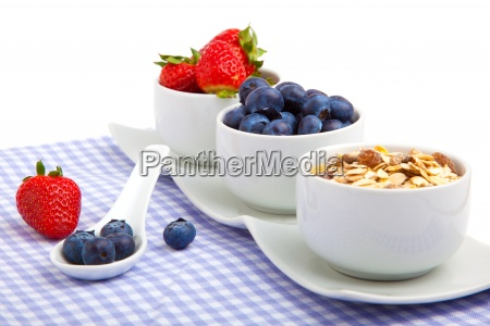 fresh berries in porcelain bowls isolated