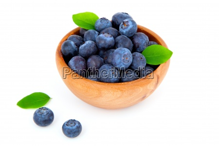 fresh blueberry in a wooden bowl