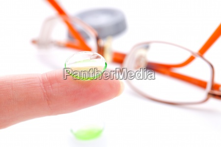 contact lens on finger isolated
