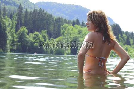 young woman standing in water in