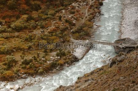 simple bridge over mountain nepal