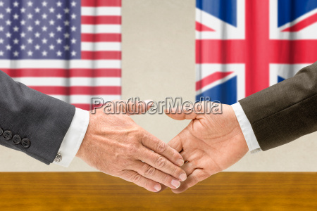 us and uk officials shake hands