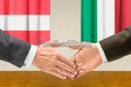representatives of austria and italy shake