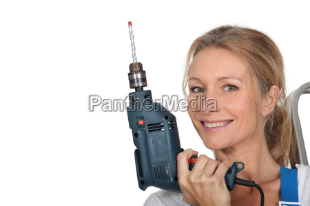 woman holding electric drill