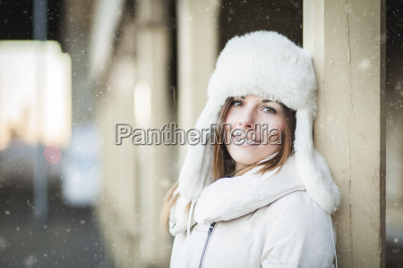 smiling young woman in blizzard