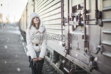 stylish woman in snowy day on