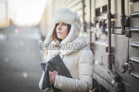 pretty girl in winter blizzard on