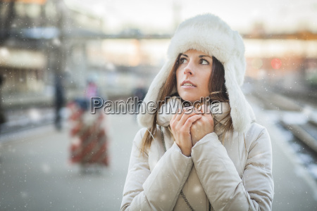 young woman feeling cold in winter