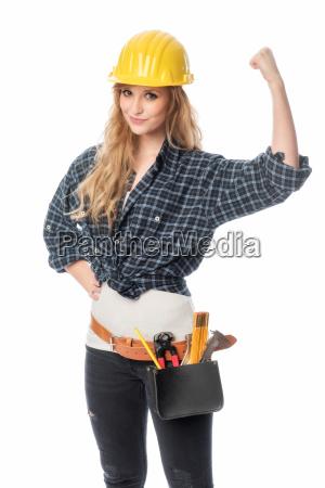 female artisan with helmet a fist