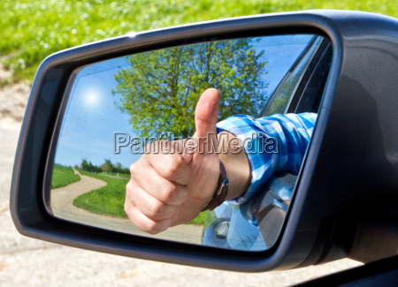 motorists with thumbs up