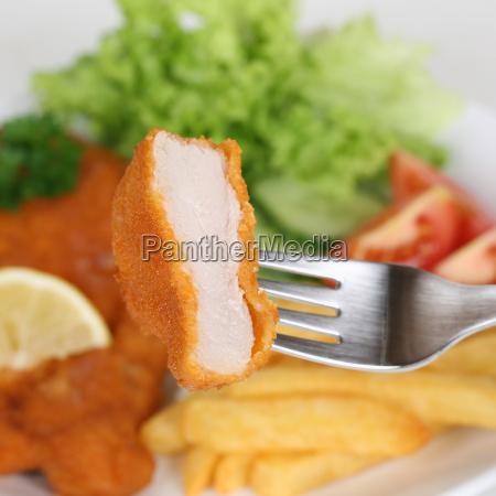 wiener schnitzel cutlet eat with fork