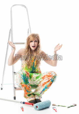 woman with stepladder and paint roller