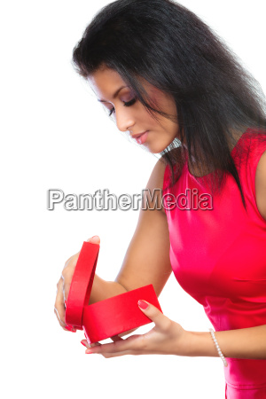 woman opening a red heart shaped