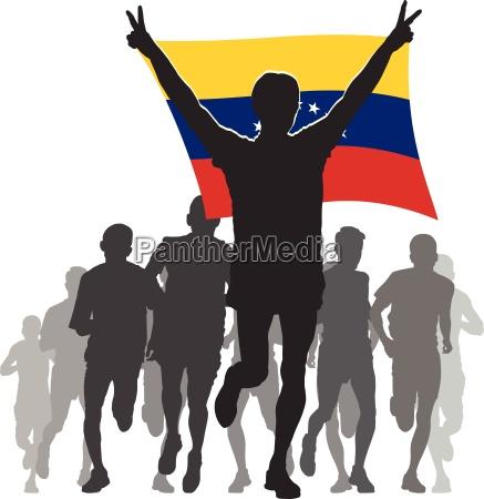 athlete with the venezuela flag at