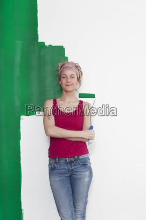 woman with paint roller in front