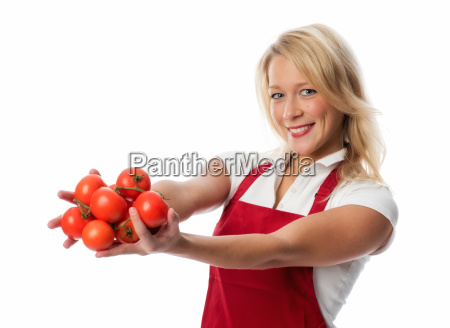 woman with apron presenting a handful
