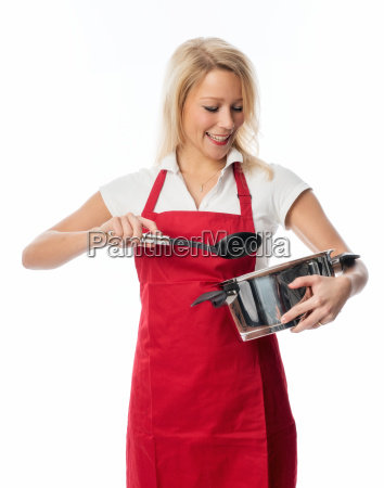 woman with apron stirred in a