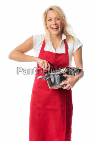 woman with red apron stirred in
