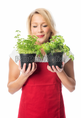 woman enjoying the smell of herbs